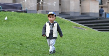 Boy playing on the Victorian State Library lawn